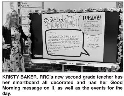 2nd grade teacher with smart board